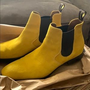 Yellow Doucals slip on boots.